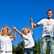 Smiling caucasian Family Playing in the garden — Stock Photo