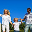 Positive caucasian Family Playing in the garden — Stock Photo