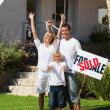 Glowing family after buying a new house - Foto de Stock