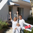 Father, mother and son in front of their new house — Stock Photo