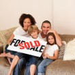 Stock Photo: Smiling family in their new house