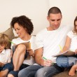 Family drawing togethe on the couch — Stock Photo #10820704