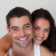 Portrait of blissful couple against white background — Stock Photo #10820781