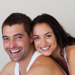 Young couple smiling at camera — Stock Photo
