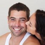 Close-up of girlfriend kissing her boyfriend — Stock Photo