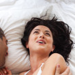 Smiling attractive woman having fun with a man — Stock Photo