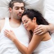 Loving couple lying in bed — Stock Photo #10820909