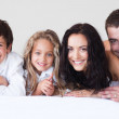 Happy family lying together — Stock Photo