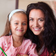Brunette mother with blond daughter — Stock Photo