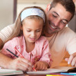 Father and cute daughter drawing together — Stock Photo