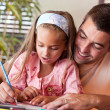 Amazed little girl drawing — Stock Photo