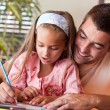 Stock Photo: Amazed little girl drawing