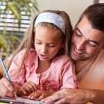 Amazed little girl drawing — Stock Photo