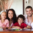 Portrait of a loving family at a braun table — Stock Photo