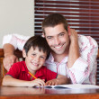Portrait of father and son drawing — Stock Photo