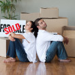 Stock Photo: Happy young couple moving house