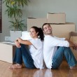 Stock Photo: Glowing couple relaxing after buying house
