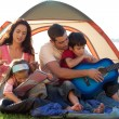 Young family in a tent playing — Stock Photo