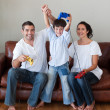 Stock Photo: Happy family playing video games