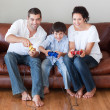 Young family playing in the living room — Stockfoto
