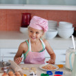 Beautiful young girl working in the kitchen — Stock Photo #10821194