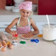 Cute girl baking cookies — Stock Photo #10821229
