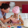 Young mother with her daughter baking — Stock Photo #10821246