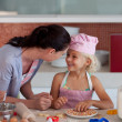 Stock Photo: Potrait of mother and daugther in kitchen