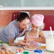 Young mother teaching child how to cook — Stock Photo