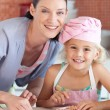 Portrait of a beautiful young mother with her pretty daughter — Stock Photo