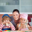 Enamoured mother with her two children — Stock Photo