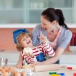 Laughing family having fun in the kitchen — Stock Photo #10821320