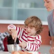 Little boy working in the kitchen — Stock Photo