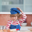 Positive little boy with a blue cap — Stock Photo