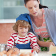 Brunette woman baking with a little boy — Stock Photo