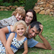 Smiling young family in the sunshine — Stock Photo #10821382