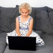 Cute girl with a laptop — Stock Photo