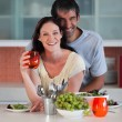 Intimate couple standing in the kitchen — Stock Photo