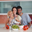 Happy familie in the kitchen — Stock Photo #10821501