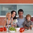 Young familie eating together — Stock Photo #10821503
