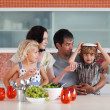 Parents with their kids in the kitchen — Stock Photo