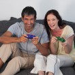 Stock Photo: Laughing couple in living room