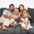 Jolly family playing video games — Stock Photo