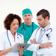 Serious team of doctors working together - Stock Photo