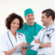 Friendly nurse with a male doctor and surgeon - Stock Photo