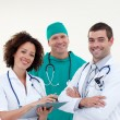 Young team of doctors smiling - Stock Photo