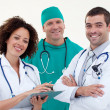 Happy young team of doctors — Stock Photo