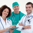 Happy young team of doctors - Stock Photo