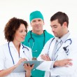 Stock Photo: Young medical team in discussion against white background