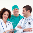 Young happy team of doctors - Stock Photo